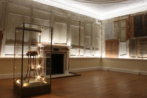 The tapestry room at Croome with plasterboard removed and dramatic lighting added